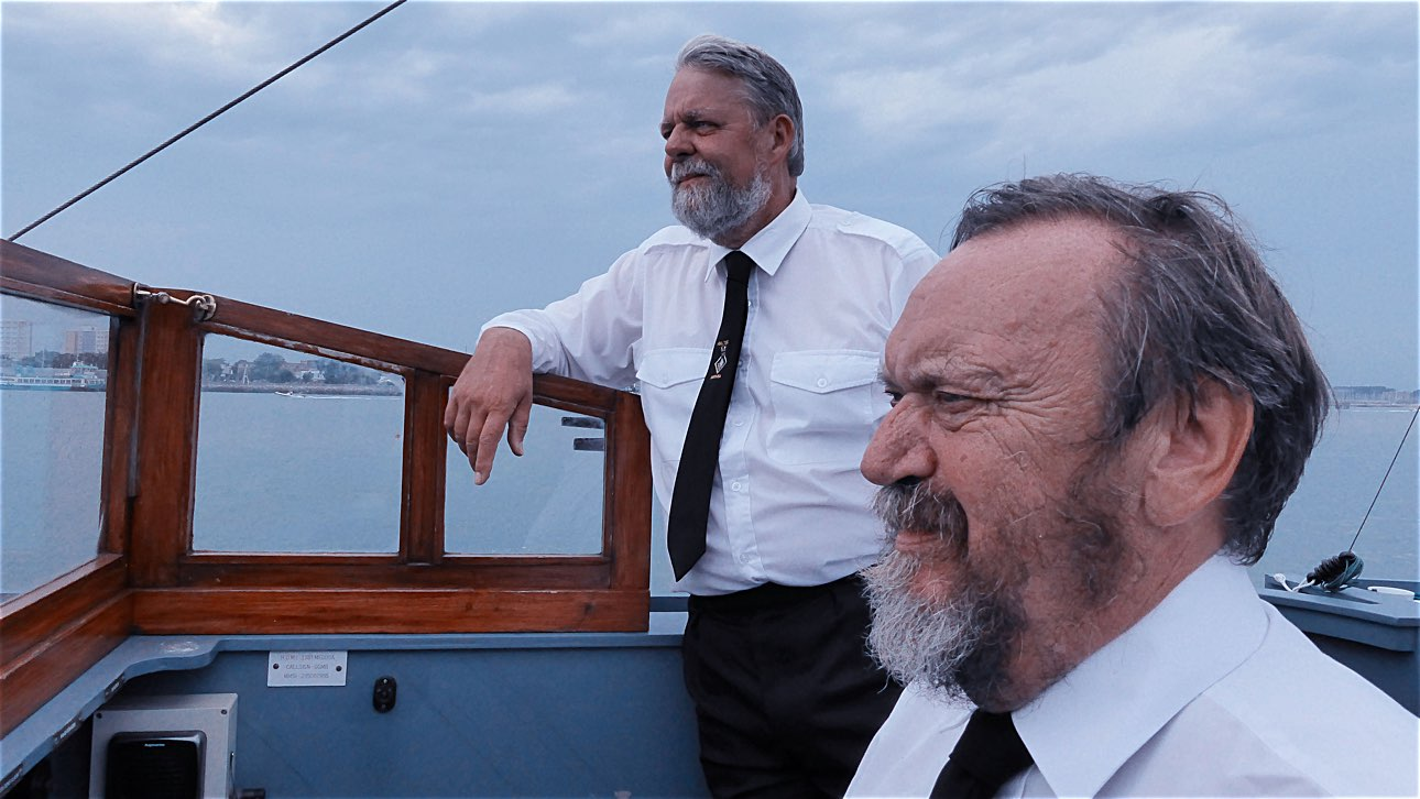 Crew members Alan Watson and Brian Holmes on the bridge of Harbour Defence Launch Medusa