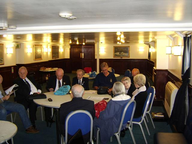 members of the london branch of coastal forces veterans meeting onboard hms belfast