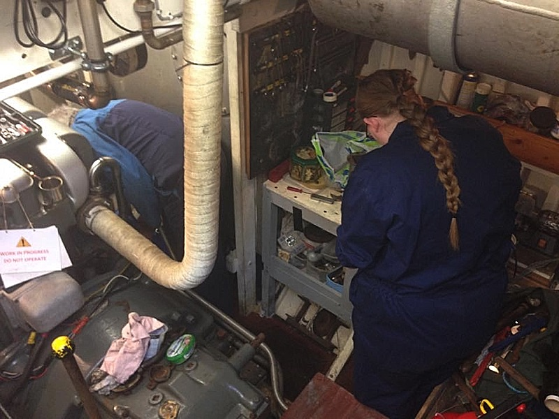 Work being carried out in the engine room of the motor launch Medusa